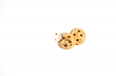 two chocolate chip cookies on white background