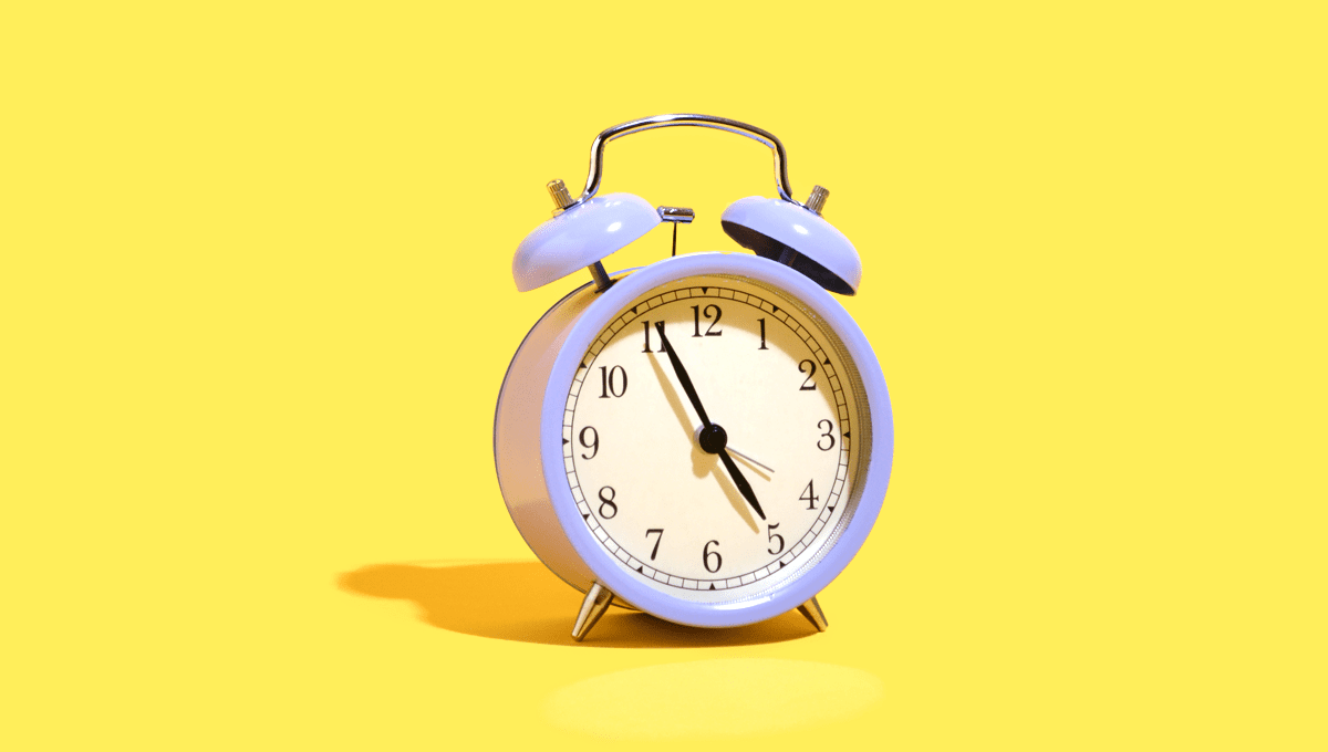 Purple clock on yellow background.